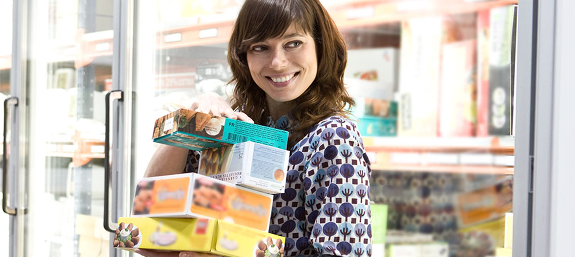 Lady with frozen goods at a supermarket